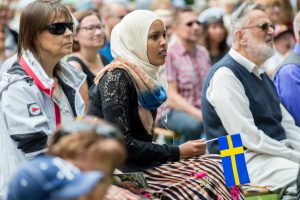 Norrkoping, Sweden - June 6, 2014: Immigrants and native Swedes participating in National day celebrations in Norrkoping. The national day of Sweden is an official holiday.